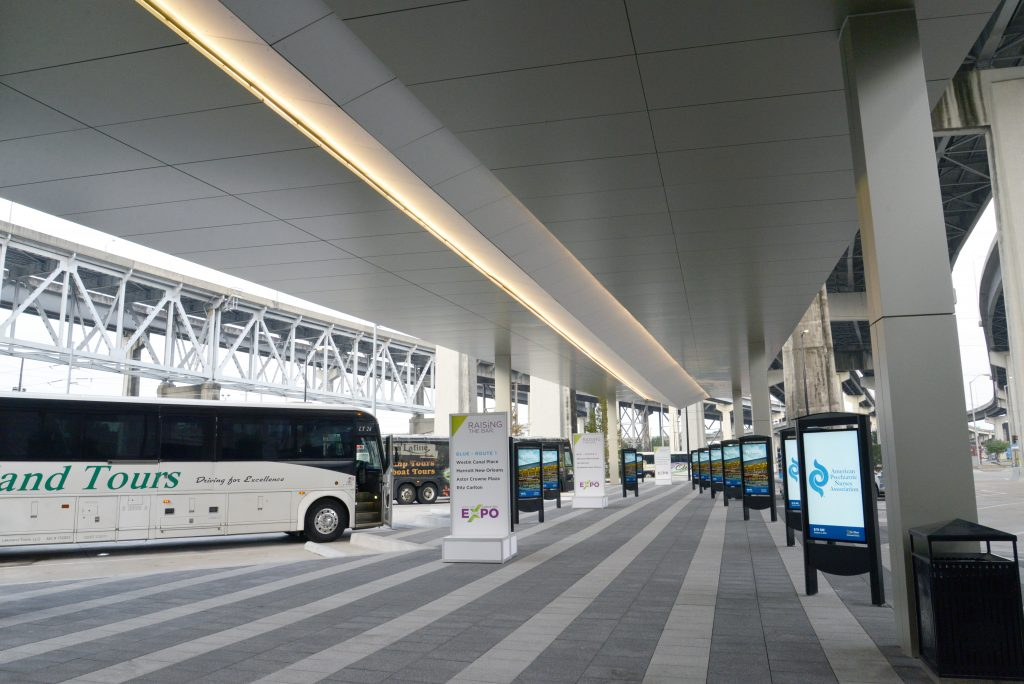 Some of the first buses to arrive at the New Orleans Ernest N. Morial Convention Center's Transportation Center await passengers.